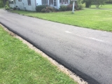 <h5>Residential Driveway</h5><p>We incorporated a patio into a regular asphalt driveway installation. Notice that some pictures show the area that was stamped. Later pictures show the color installation. This is a nice cost-effective way to add beauty to a typical asphalt driveway. </p>