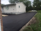 <h5>Stamped Asphalt</h5><p>These pictures show a complete removal and replacement of an existing driveway. Care was taken to improve the base by removing clay and installing base material. The driveway was then compacted and paved in two courses.</p>