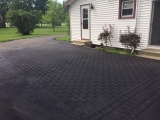 <h5>Stamped Asphalt</h5><p>We incorporated a patio into a regular asphalt driveway installation. Notice that some pictures show the area that was stamped. Later pictures show the color installation. This is a nice cost-effective way to add beauty to a typical asphalt driveway. </p>