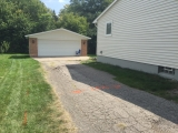 <h5>Residential Driveway</h5><p>These pictures show a complete removal and replacement of an existing driveway. Care was taken to improve the base by removing clay and installing base material. The driveway was then compacted and paved in two courses.</p>